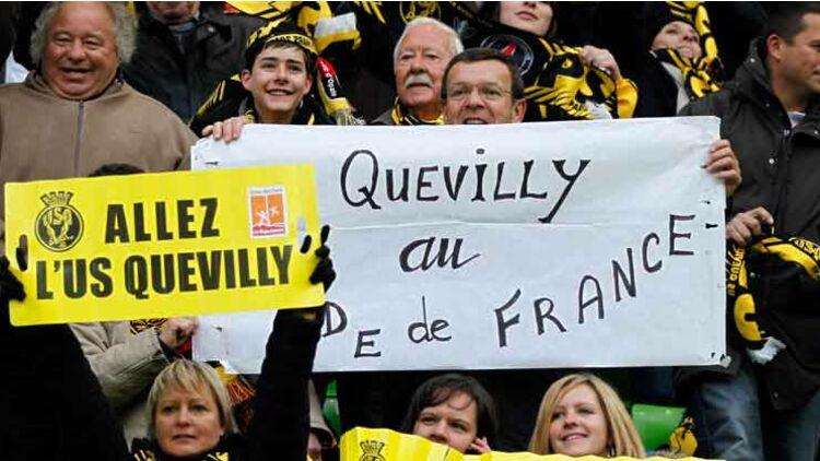 fDes supporteurs de l'US Quevilly lors de la demi-finale de la Coupe de France contre le PSG, le 14 avril 2010. © REUTERS.
