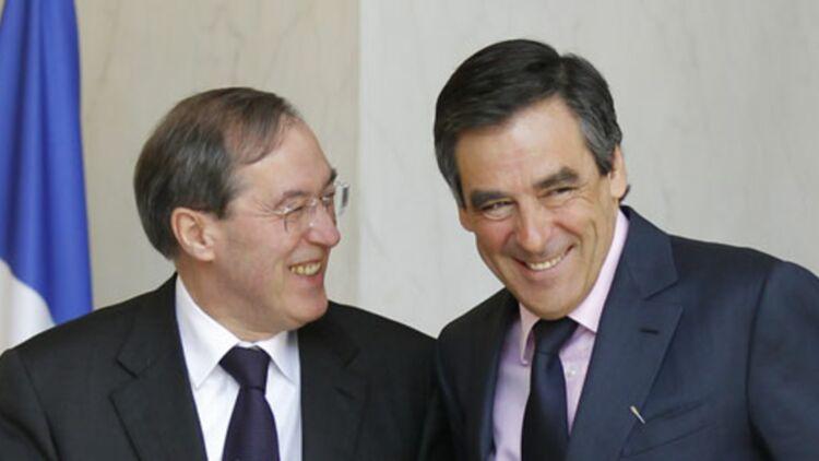 Malgré des parachutages à haut risque, Claude Guéant et François Fillon restent optimistes pour les élections législatives de 2012. © REUTERS.