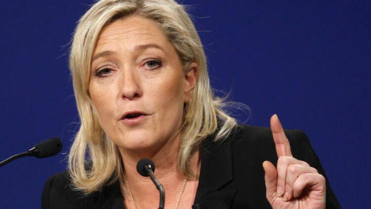 Marine Le Pen demande l'anonymat des sigantaires. Sa requête a été transmise au Conseil constitutionnel. ® REUTERS.