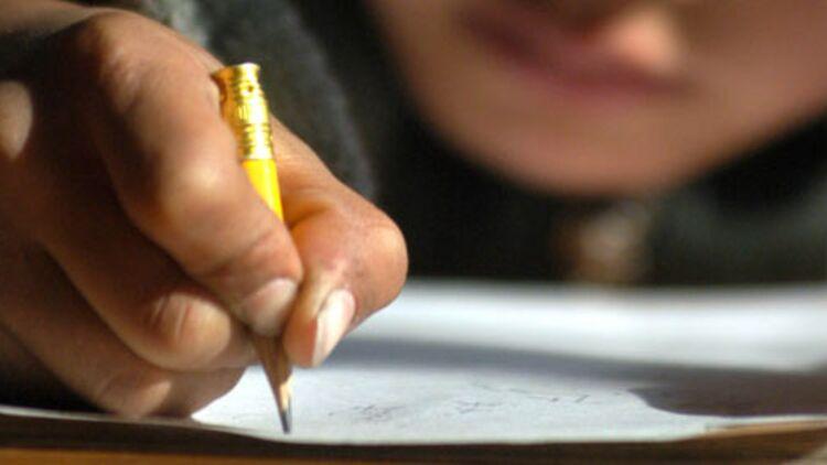 Un arrêté de novembre 1956 interdisait déjà les devoirs écrits à la maison. © REUTERS