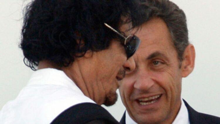 Nicolas Sarkozy et Mouammar Kadhafi au G8 de L'Aquila, en Italie, en juillet 2009. ©REUTERS