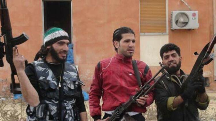 Des membres de l'Armée syrienne libre, le 29 février 2012 à Homs. © REUTERS.