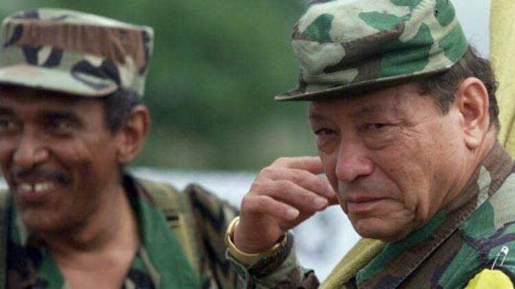 Aujourd'hui décédé, Manuel Marulanda (à droite) était le chef historique des Farc. ©REUTERS