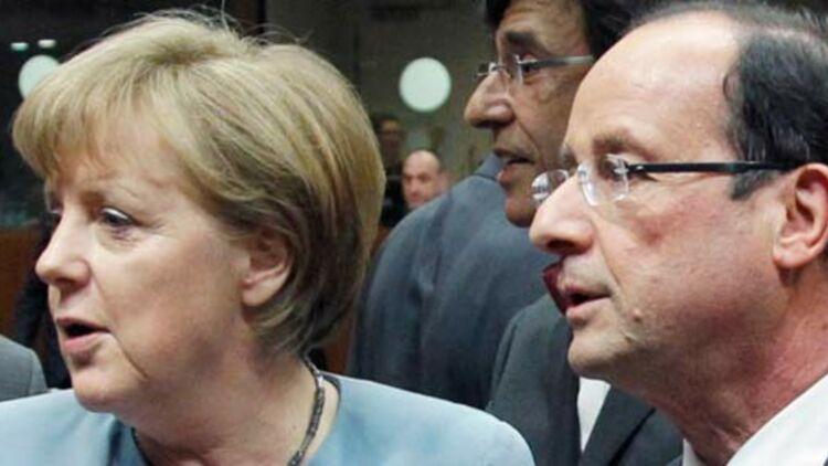 Angela Merkel et Fraçois Hollande lors du sommet informel à Bruxelles le 23 mai 2012. © REUTERS