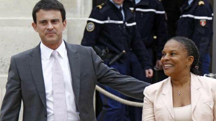 Le ministre de l'Intérieur Manuel Valls et la ministre de la Justice Christiane Taubira après le premier conseil des ministres. © REUTERS