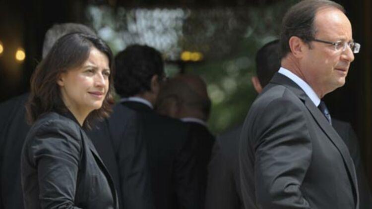 Le blocage des loyers est une mesure d'urgence dans l'attente d'une loi cadre sur le logement qui sera présentée par la ministre du Logement Cécile Duflot (à gauche sur la photo, à côté de François Hollande), début 2013. © REUTERS