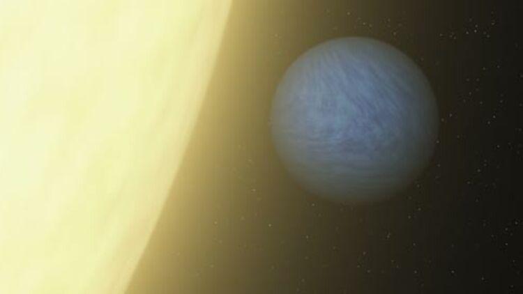 Représentation par un artiste de la NASA de la planète 55 Cancri e en orbite autour de son étoile, dans la constellation du Cancer. © REUTERS