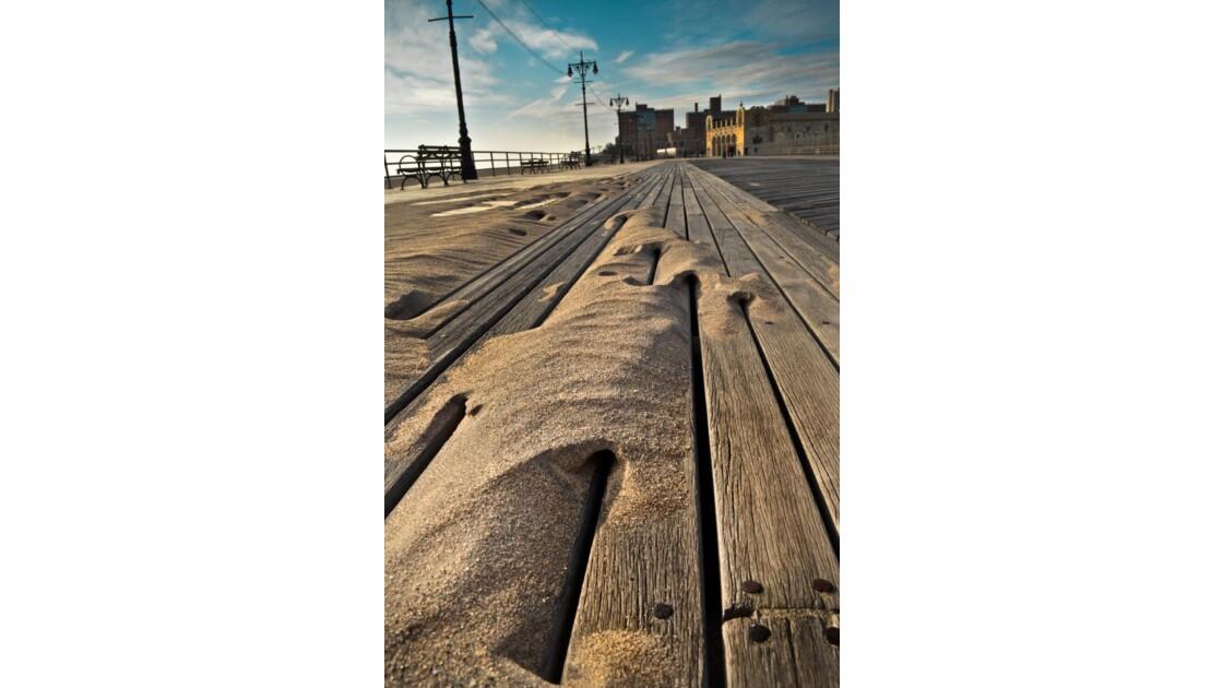 Coney Island, dessiné par le sable.