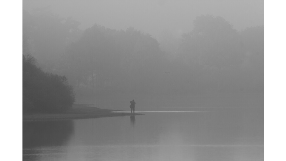 Pecheur dans la brume
