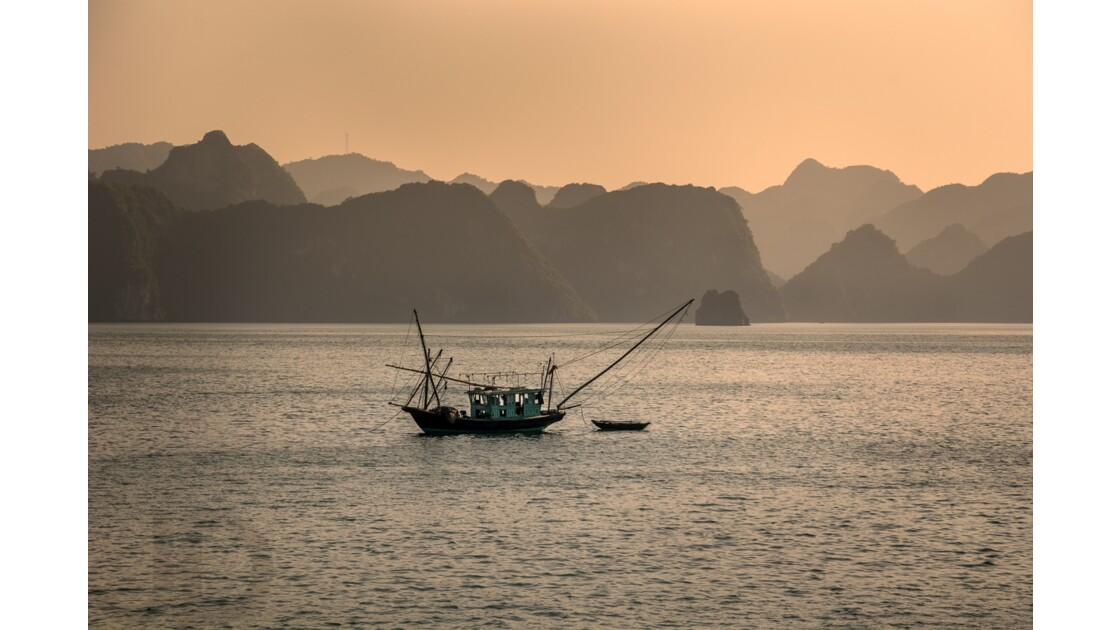 Fishing boat in Ha Long bay