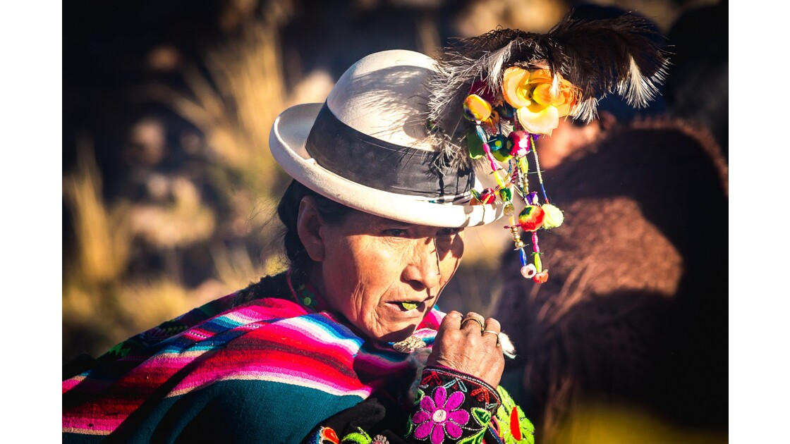 Aymara woman eating Coca