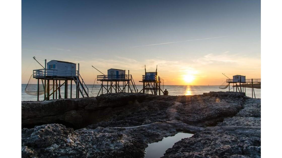 Carrelets de pêche au soleil couchant