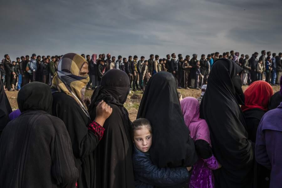 """A Mossoul, des civils en passe de recevoir de l'aide - Catégorie """"photo de l'année"""""""